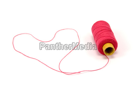 heart shape made of red thread
