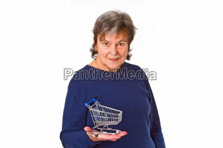 senior with model shopping cart