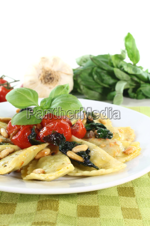 cappelletti with pine nuts and tomatoes