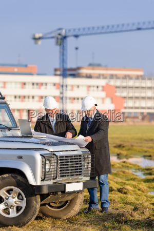 two architects at construction site