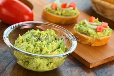 fresh avocado cream in glass bowl