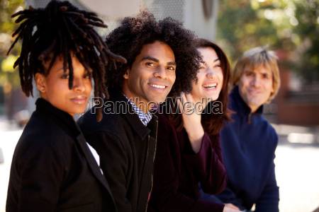 diverse group of four friends relaxing