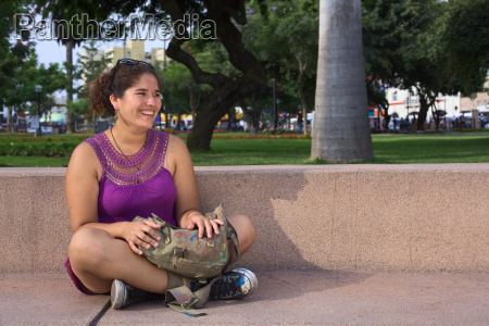 young peruvian woman in park in