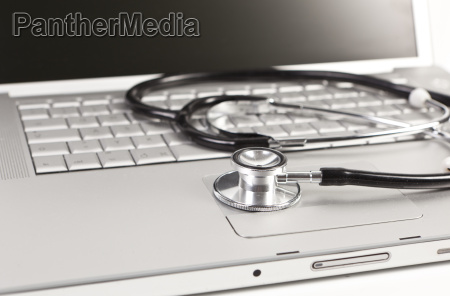 notebook and stethoscope