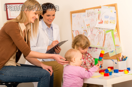 pediatrician female observe children play activity