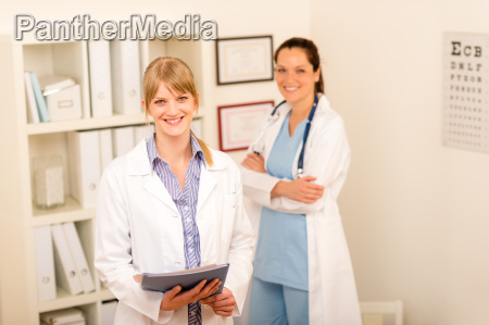 two female doctor standing at medical