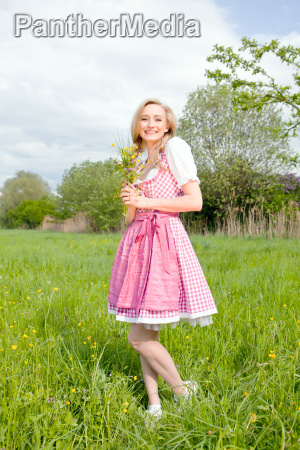 young woman with a pink dirndl