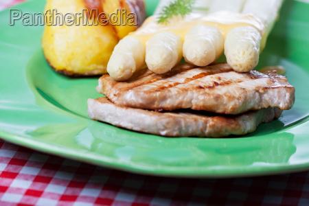 white asparagus and pork loin