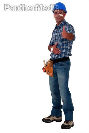 injured handyman giving the ok gesture