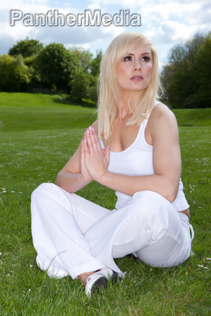woman meditating and looking to heaven