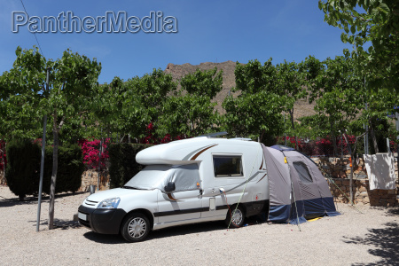 camper van with tent on a