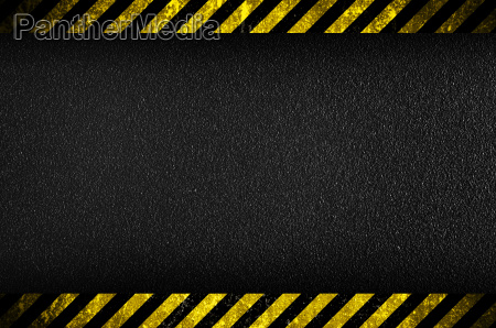 dark background with yellow caution stripes