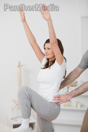 woman doing exercise while a man