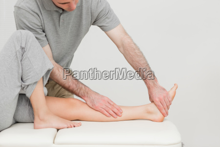 calf of a patient being stretched