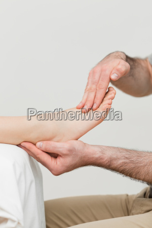 practitioner holding the foot of a