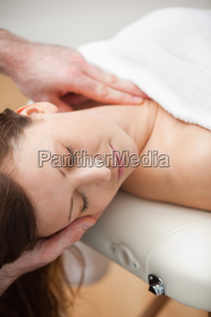 neck of a patient being massaged