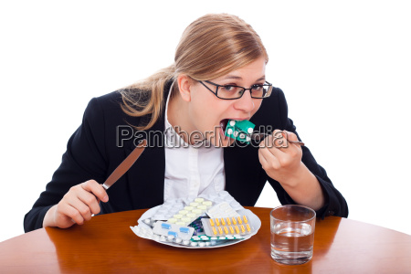 woman eating drugs tablets and pills