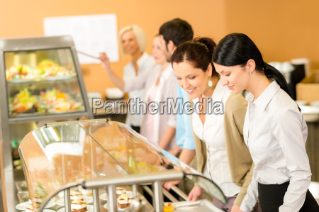cafeteria lunch two office woman choose