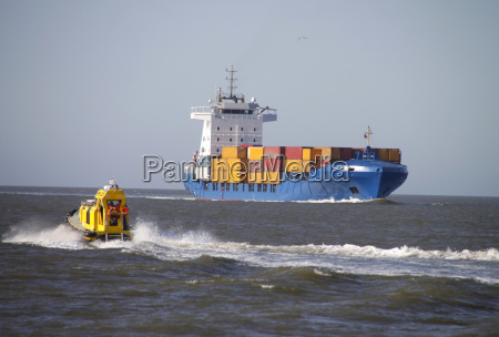 container ship and pilot boat