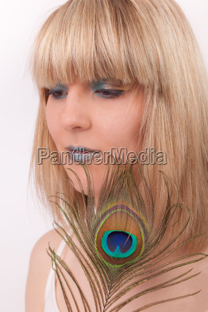 young woman with peacock feather