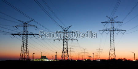 electricity pylons at dusk on the