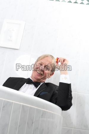 man in tuxedo in the bathtub
