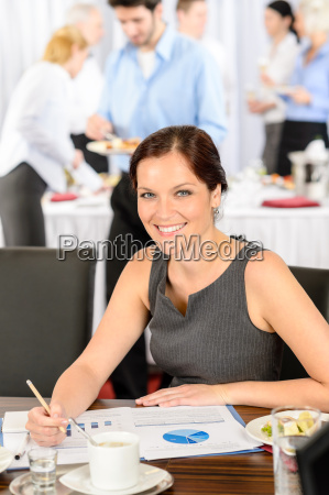 business woman work during catering buffet