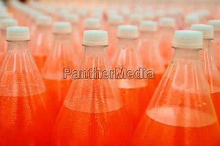 orange juice beverage plastic bottle in