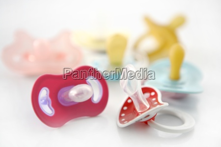 baby pacifier set over white background