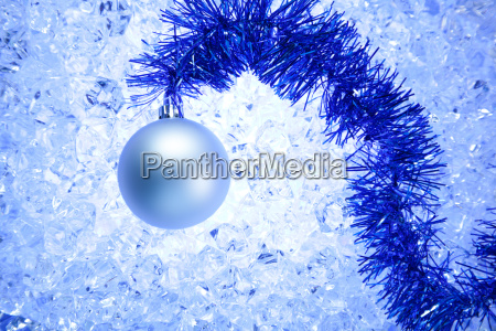 christmas silver bauble on blue winter