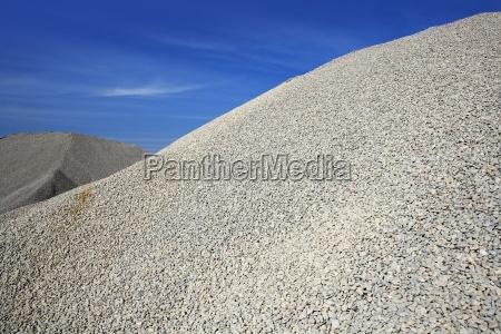 gravel gray mound quarry stock blue