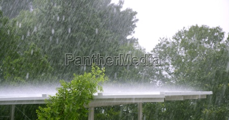 raining over a white roof in