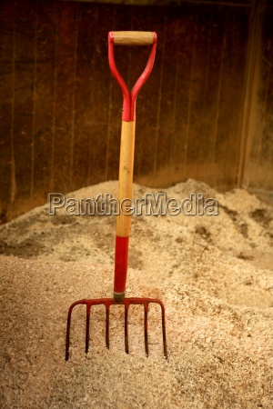 horse stable witth straw fork tool