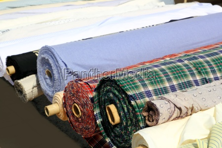 colorful fabric rolls row in market