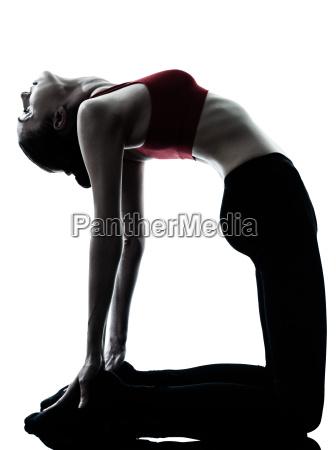 woman exercising yoga camel pose