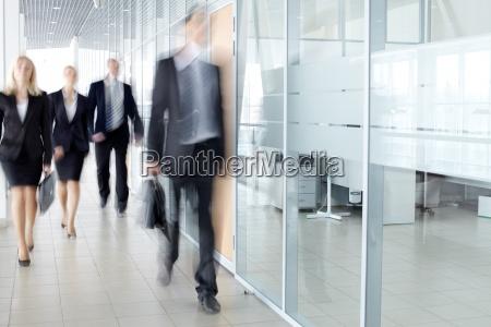 businesspeople in corridor