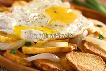 fried egg on fried potatoes