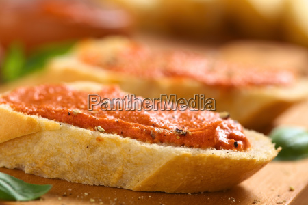 tomato butter spread on baguette