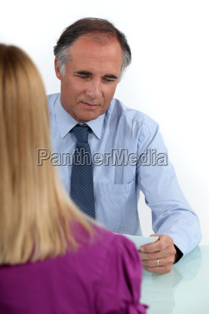 mature businessman in office with young