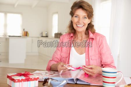 senior woman scrapbooking