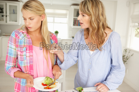 mother and teenage daughter arguing about