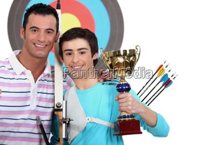 little boy winning an archery contest