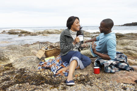 couple having picnic on beach