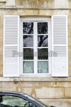 old windows with shutters paris france