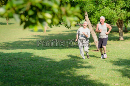 active senior people jogging in city