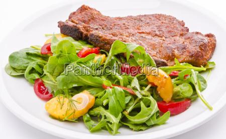 cervical chop with apricot rocket salad