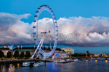 london eye and huge cloud on