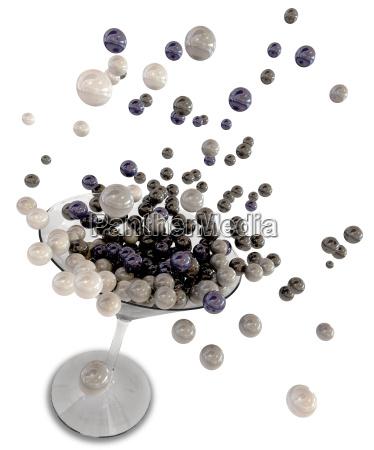 martini glass splashing glossy spheres