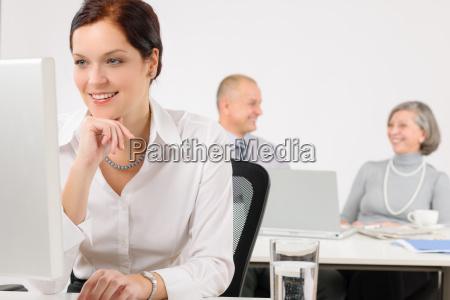 young executive woman look at computer