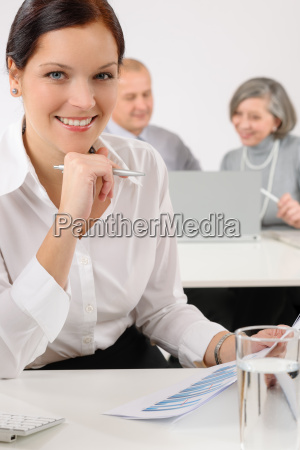 young executive woman review charts